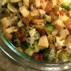Roasted Brussels Sprouts with Apples, Golden Raisins, and Walnuts - Brussels sprouts are roasted with apples and cauliflower and tossed with golden raisins and walnuts for a sweet and savory side dish.
