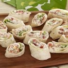 BLT Rollers - We've never met a BLT we didn't like, and our tortilla version is no exception. All the elements of the classic, rolled and cut into bite-size pieces to share with your peeps.