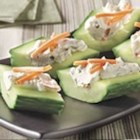 Cream Cheese 'n Herb Cucumber Bites - So fast and easy, hollowed out cucumber 'boats' are filled with a creamy chive and onion mixture with grated carrots, then cut into bite-size pieces.