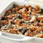 Three-Cheese Chicken Penne Pasta Bake - Chunks of chicken in a creamy tomato sauce with basil and fresh spinach are baked with multi-grain penne pasta and topped with cheese.