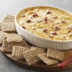 Warm Reuben Spread - Served as a spread or dip, classic Reuben sandwich ingredients--corned beef, sauerkraut, and Swiss cheese--are baked in a creamy base for a sure-fire party hit.