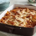 Creamy Baked Ziti - Ziti pasta bakes with layers of creamy tomato sauce and mozzarella cheese in an easy and comforting dish that's ready in less than an hour.