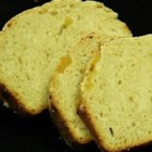 Lemon Ginger Loaf - A yeast bread loaf flavored with crystallized ginger. The dough is made in a bread machine and baked in the oven.