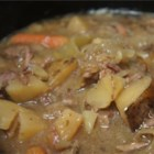 Slow Cooker Beef Stew IV - Red wine and onion soup mix flavor this beef stew made with potatoes, carrots, and onions.