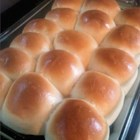 School Lunchroom Cafeteria Rolls - These rolls are JUST like the ones the cafeteria ladies make in the school lunch rooms!  My 8 year old daughter loves the cafeteria rolls and said my recipe was even better!  You can't mess these up!  They are super easy and everyone will want the recipe! We eat the leftovers for breakfast or put cheese and turkey in warmed rolls for a quick lunch!