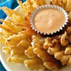 Blooming Onion - A delicious onion sliced to bloom, then coated and deep-fried. The recipe for the dipping sauce is also included.