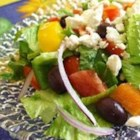 Greek Salad I -  An oregano/olive oil dressing with a dash of lemon makes this traditional salad just a bit different. All the veggies, including the Romaine, are chopped so when the salad is tossed, each bit of tomato or pepper, or cucumber gets its equal share of dressing. Six servings.