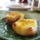 Portuguese Custard Tarts - Pasteis de Nata - A rich egg custard poured into individual pastry-lined muffin cups and baked.