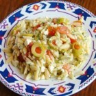 Orzo and Tomato Salad with Feta Cheese - A cold pasta salad with orzo, green olives, feta cheese, parsley, dill, tomato, olive oil, and lemon juice.  If you don't have fresh herbs, use dried, but be sure to use more to make up the difference in flavor.