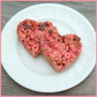 So Pink Cereal Bars   - Bright pink marshmallow cereal squares flavored with cranberry gelatin, dried cranberries, and little candy-coated chocolate pieces make a pink and pretty Valentine treat.
