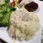 Aimee's Mashed Cauliflower 'Potatoes' - Steamed cauliflower and a bit of mashed potato flakes make a comforting side dish.