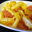 Warm Winter Citrus Dessert - A simple dessert--or breakfast dish--of broiled grapefruit, orange, and pineapple topped with butter and brown sugar.