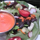 Roasted Red Pepper Vinaigrette - This dressing is great served slightly warm and tossed with greens. It's even better with freshly grilled chicken, artichoke hearts or hearts of palm!  Unused amounts may be covered and refrigerated for up to a week.