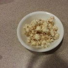 Healthy Popcorn Treat - Popcorn popped in coconut oil and tossed in honey and cinnamon is a healthier version of sweet popcorn that everyone in the family will enjoy.