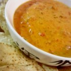 Super Bowl(R) Dip - A cheesy, spicy hot sausage and salsa dip stays warm in the slow cooker. It's perfect for watching the game on a cold day.