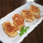 Southern Style Chicken Toast - Small triangles of bread are coated with a minced chicken mixture and pan fried until golden brown. It is similar to the Chinese dim sum dish, shrimp toast.