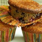 Nutty Raspberry Chocolate Muffins - Raspberries, banana, almond meal, and dark chocolate chips give muffin batter a colorful and healthier twist that everyone in the family will appreciate.