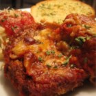 Eggplant Parmesan II - Eggplant slices are dipped in egg and bread crumbs and then baked, instead of fried.  The slices are layered with spaghetti sauce, mozzarella and Parmesan cheeses.