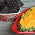 Avocado and Black Bean Dip - Avocado and black beans are warmed with a Cheddar cheese topping for a colorful and fiber-filled dip. Serve with pita or tortilla chips.