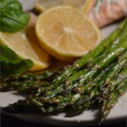 Lemon Asparagus - Simply roasted asparagus is tossed with a lemon butter sauce for a quick and easy side dish.