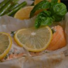 Parchment Baked Salmon - A salmon fillet is steamed in parchment paper with lemon and basil for a light, quick meal for two.