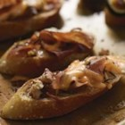 Fig-Proscuitto Crostini - Fig with prosciutto--a classic flavor pairing--with walnuts, shredded Cheddar cheese, and fresh rosemary make an easy yet elegant appetizer on baguette rounds.