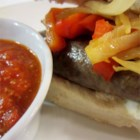 Sausage Grinder - Cook up a pan of Italian sausages, layer them in hoagie rolls with hot peppers, onions, and cheese for a hearty and satisfying meal.