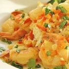 Curry-Coconut Shrimp - Jumbo shrimp in a lightly spiced coconut curry sauce. Serve over hot cooked brown rice.