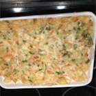 Easy Cheesy Tuna Casserole - A combination of pasta, tuna, mixed vegetables, mushroom soup and cheese cooked in a casserole.
