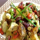 Roasted Potato Salad with Balsamic Dressing - Chunks of potatoes are roasted with herbs for intense flavor, then combined with Mediterranean-inspired ingredients like artichoke hearts, kalamata olives, and Gorgonzola cheese. A homemade balsamic vinaigrette dressing is poured over the savory salad. Serve warm or cold!