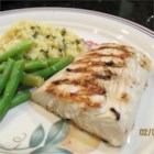 Garlic-Lemon Mahi Filets - A marinade of white Zinfandel wine, garlic, and lemon juice gives your mahi mahi fillets a nice flavor before heading to the grill.