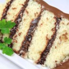 Doberge Cake (Dobash) - Doberge Cake is a traditional Louisiana cake, just right for Mardi Gras. The thin layers of white cake are spread with chocolate pudding, and the whole cake is iced with homemade chocolate frosting.