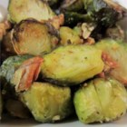 Roasted Brussels Sprouts with Pecans - Brussels sprouts are simply oven-roasted with pecans and a light olive oil and garlic glaze.