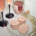 Champagne Cookies - Festive cookies are tinted pink and topped with candy sprinkles. The dough is made with a cup of champagne.
