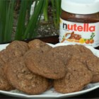 Nutella® Hazelnut Cookies - Chocolate-hazelnut spread, cocoa powder, chocolate chips, and chopped toasted hazelnuts make these cookies perfect for Nutella® lovers!