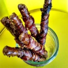 Bacon Wrapped Pretzels - Pretzel rods are wrapped in spicy brown sugar-coated bacon slices and baked for a sweet and savory appetizer perfect for your next get-together.