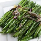 Haricots Verts Lyonnaise - This green bean recipe is worth the extra effort!  The beans are boiled, blanched then sauteed with garlic, red onion, thyme and red wine vinegar.
