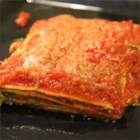 Ravioli Lasagna - Lasagna is a snap when you use frozen cheese raviolis layered with spinach, Romano cheese, and ricotta, then baked with sauce.