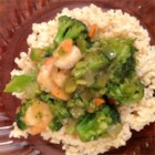 Easy Shrimp Vegetable Stir Fry - Sweet caramelized shrimp and veggies served over a fluffy bed of brown rice makes an easy and crowd pleasing meal!