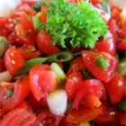 Fresh Mild Salsa - This mild salsa is made with fresh tomatoes, garlic, bell pepper, and serrano and jalapeno chile peppers, and can be made more spicy by using more serrano peppers.