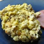 Pesto Scrambled Eggs - A scrambled egg with a little pesto stirred in. Sounds good... IS good. Try it on a slice of toast.