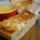 Lisa's Best Ever Garlic Bread - Real butter, sliced garlic cloves, and French bread give this easy side dish an authentic flavor.