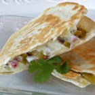 Southwestern Corned Beef Quesadillas! - Leftover corned beef brisket is a perfect addition to a spicy green chili and cheese quesadilla for two.
