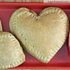 Heart Shaped Whole Wheat Mini Calzones - Heart-shaped calzones with a creamy broccoli and chicken filling are the perfect dinner to make for your family on Valentine's day.