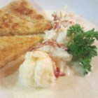 Lobster Fricassee - Lobster is steamed in white wine then served in lobster scented cream sauce. This is a specialty of Jean-Baptiste Molinari of Dromoland Castle.