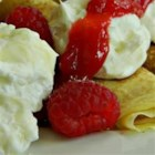 Lemon Snow Filling - Fill your favorite crepe recipe with this creamy lemon filling. Top with raspberry sauce, and garnish with fresh raspberries.