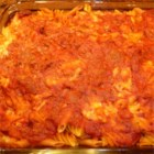 Fanny's Italian Casserole - Here's an Italian-inspired pasta and meat sauce bake that will remind you of lasagna, but it's made with macaroni, Cheddar cheese, and dressed-up purchased spaghetti sauce to make it easy to assemble.