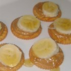 Peanutty Minis - Buttery round crackers are topped with peanut butter, honey, and banana for a quick and easy treat for all ages.