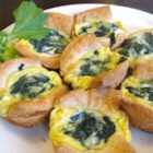 Croissant Mini Quiche - Buttery croissants make up the base of these cheese and spinach mini quiches. Serve as a quick and easy appetizer or brunch item that will make everyone come back for more.