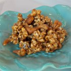 Cashew Caramel Corn - Popcorn and cashews are coated in a sweet, caramel glaze for a crunchy Halloween treat.